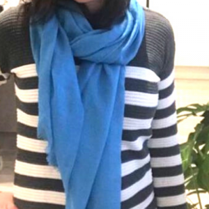 Girl wearing a cornflower blue plain scarf