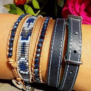 A wrist full of stacking braclets including the fabulous leather reversible belt-buckle bracelet by Boho Betty