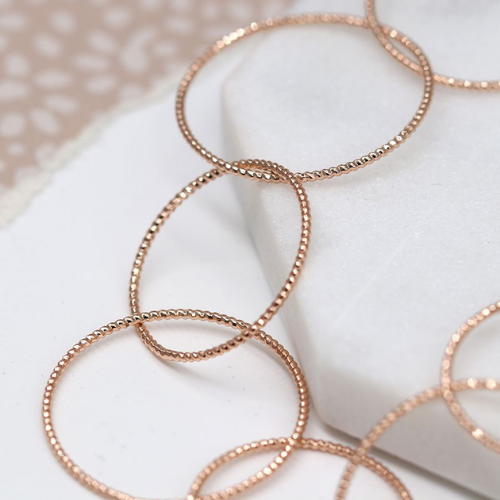 Close up of Rose Gold Textured Hoop Necklace