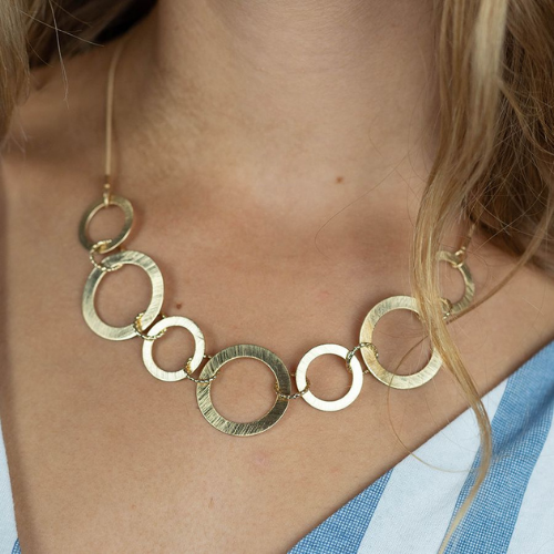 Lady wearing matte gold scratched circles necklace with snake chain - Jewellery - Spirit & Grace Style