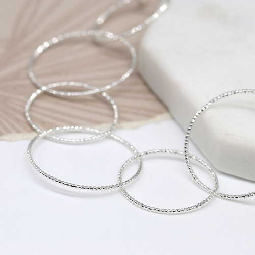 Close up of Silver Textured Hoop Necklace