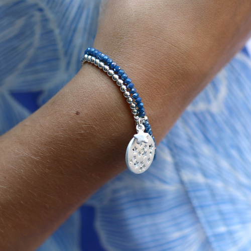 Lady wearing midnight blue & silver double strand star charm bracelet - elasticated - Spirit & Grace Style Jewellery Collection