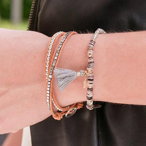 A lady is wearing this tan leather bracelet stacking combination from Boho Betty