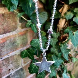 Long Beaded Chain adorned with mini star charms and large star pendant