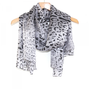 A leopard print scarf made of pure silk hanging on a hanger Dark Grey & Black Leopard Print Scarf