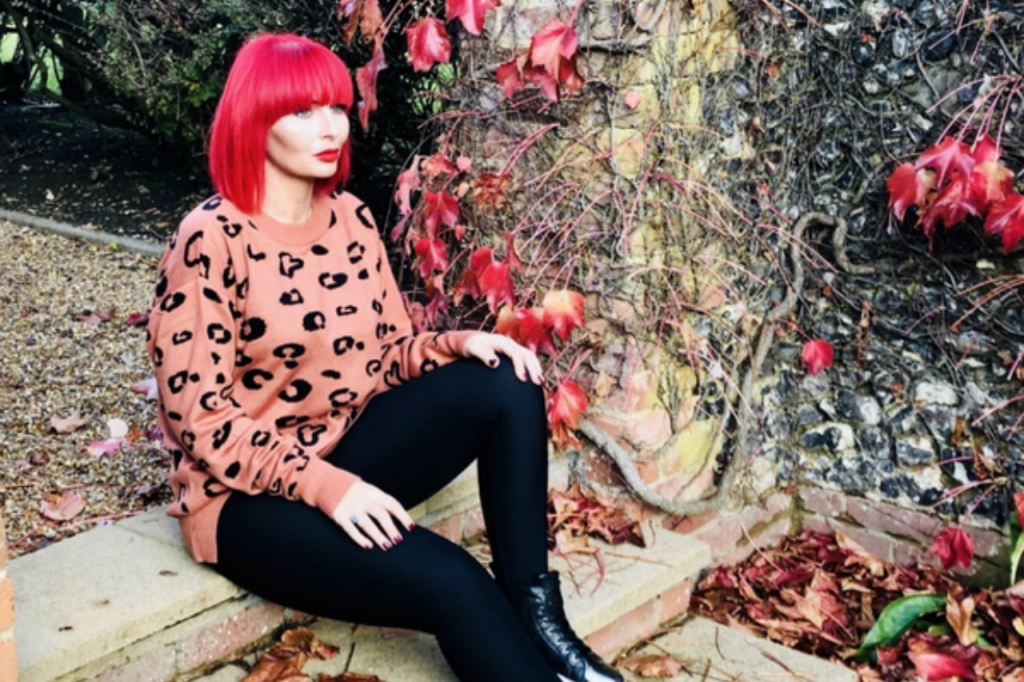 Spirit & Grace Style Edit - Hayley Saunders - Owner & Founder of Miss Red London sitting on steps wearing pink leopard print jumper